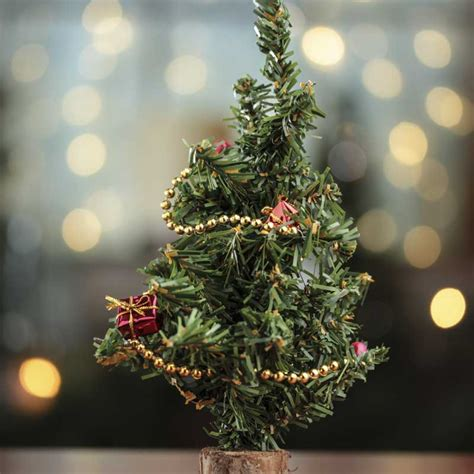 decorated mini artificial christmas tree holiday florals