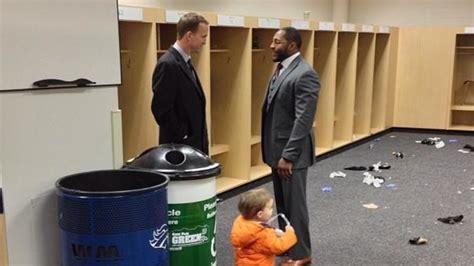 saturday live peyton manning locker room the uplifting postgame photo of peyton manning talking to lewis