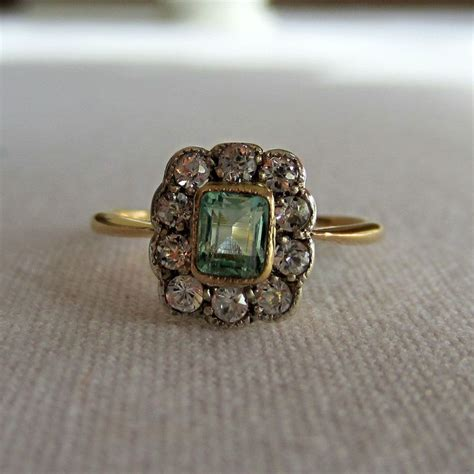 reserved antique emerald and halo ring early