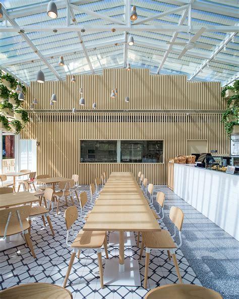 design hub greenhouse cafe botanical brew four o nine converts greenhouse into