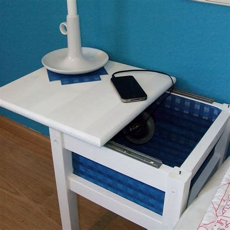 ikea nightstand charging station so clever the sliding top to this bedside table means you