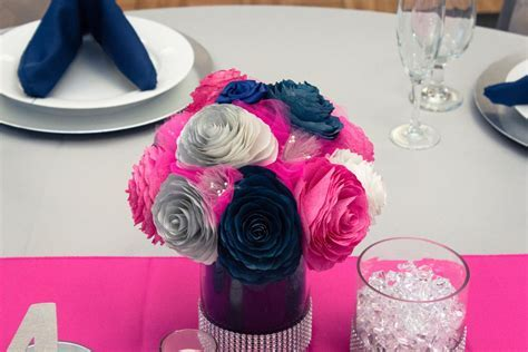 Navy blue, hot pink and silver wedding table centerpieces
