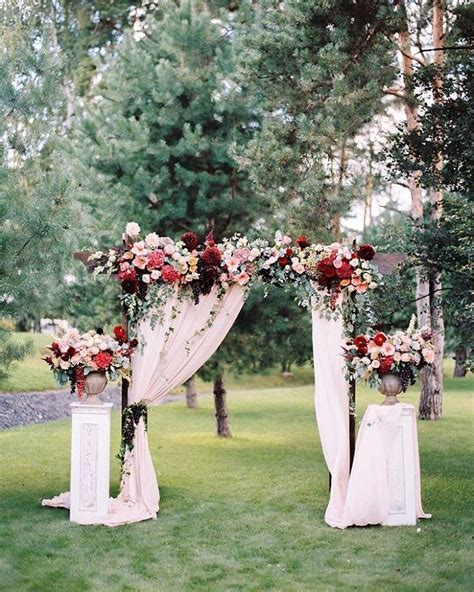 Fabric draped wedding arch   wedding arch with fabric draping