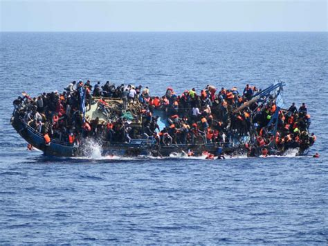 sinking migrant boat dramatic video shows migrants rescued from sinking ship