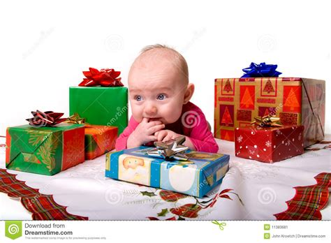 baby lying amongst christmas gifts stock image image
