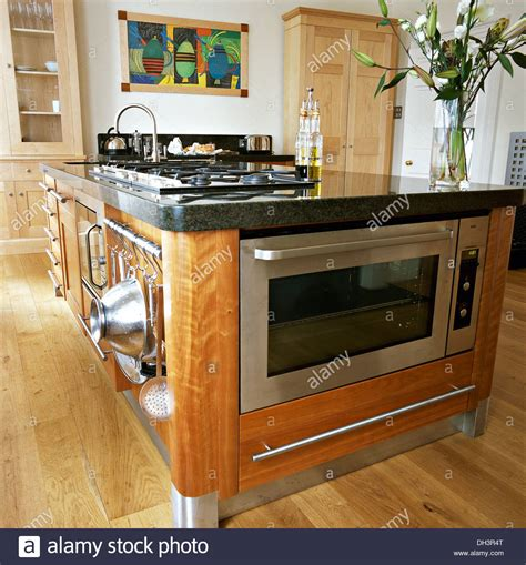 kitchen central island stainless steel oven and integral hob in central island