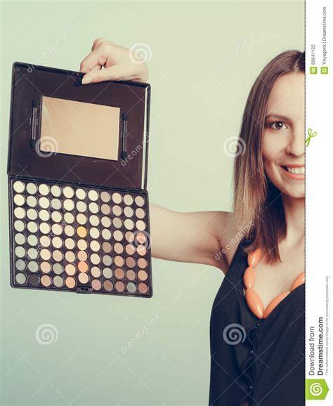 Makeover Eyeshadow Pallete stylist holding eyeshadow makeup palette stock