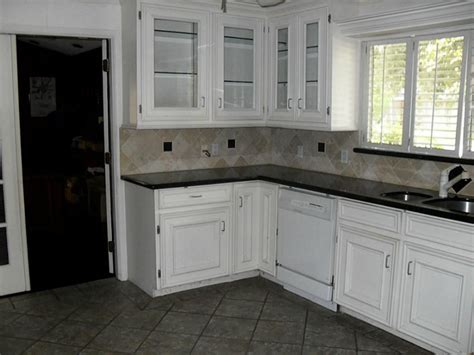 white kitchen cabinets tile floor cabinets kitchen white kitchen reno kitchen remodel tile