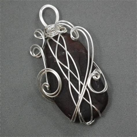how to make jewelry with wire wrapping techniques wrap a with a 4 strand braid wire jewelry wire