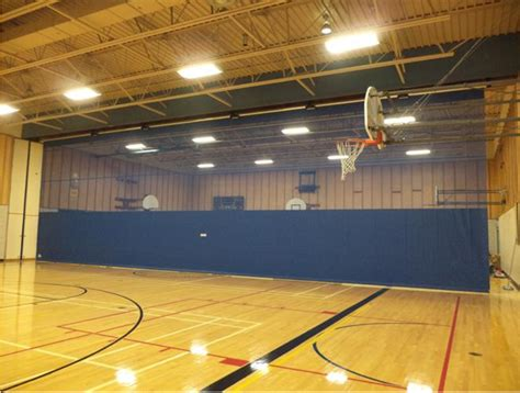 gym curtain divider the benefits of motorized gym divider curtains