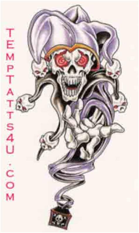 skull joker tattoo designs red eyes joker skull tattoo design