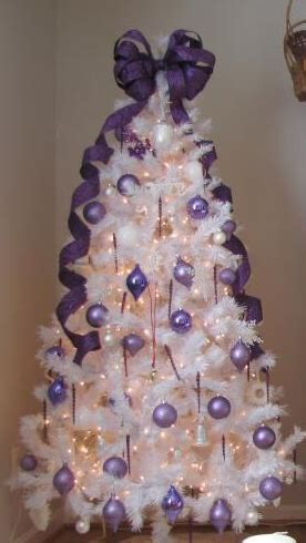 white christmas tree with purple ornaments christmas
