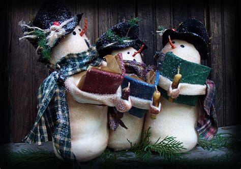 christmas caroling snowmen famil