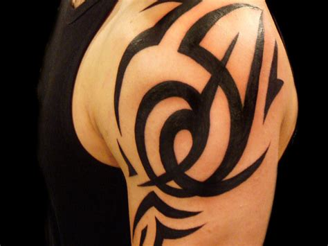 badass shoulder tattoos 30 oustanding tribal shoulder tattoos slodive