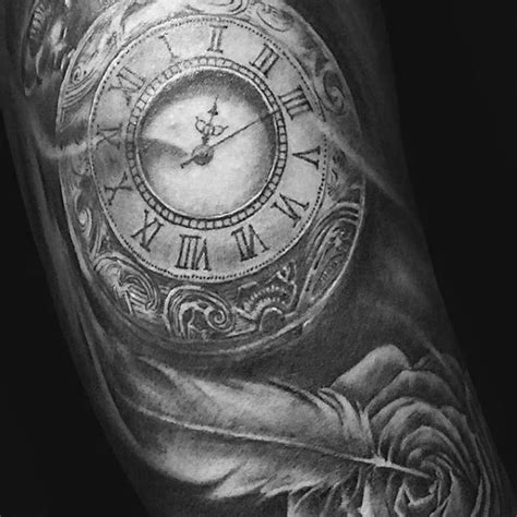 tattoo feather clock 70 feather tattoo designs for men masculine ink ideas