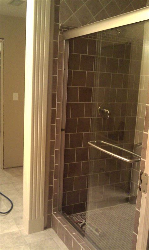Wooden Shower Doors Walk In Shower With Frameless Glass Sliding Shower Door Made White Wooden Column Caps The