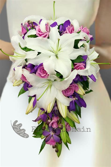 wedding bouquet lilies and orchids white purple orchid and mauve trailing
