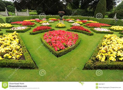 Formal Garden Design - formal garden beds with urn royalty free stock photography image 26219817