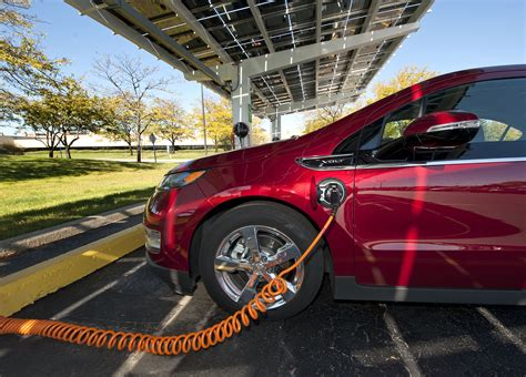 chevy volt solar charger chevrolet volt in one of ten new solar powered charging