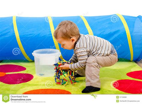 how to your to put his toys away child cleaning up stock photo image 37136980