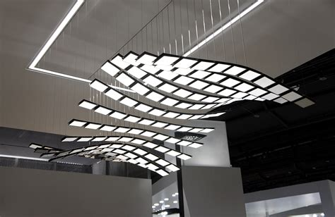 A New Experience Of Light For Interiors Selux Manta Rhei Moving Ceiling Light Fixture
