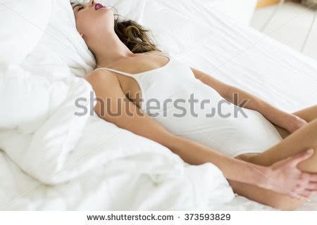 how to meditate in bed yoga meditation woman relaxing homehealthy lifestyle stock