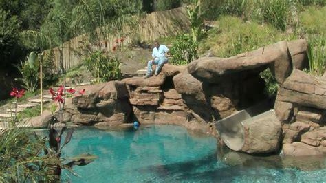 pool in backyard tropical backyard pool spa ideas youtube