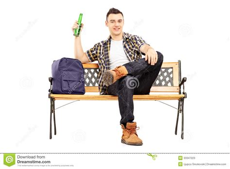 student benches young satisfied student sitting on a bench and drinking beer stock photos image