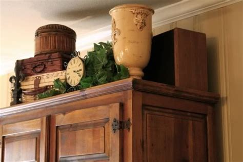 decorating armoire tops great idea for decorating an armoire home decor pinterest