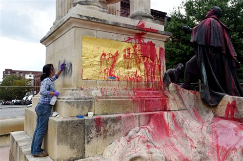 experts assess damage  key statue  vandal good