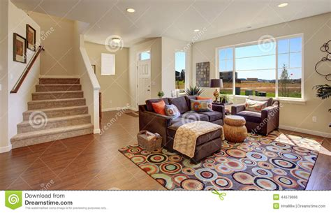 Brown Living Room Clipart Living Room With Brown And Cheerful Rug Stock Photo
