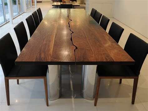 modern dining table in solid walnut and aluminium fine
