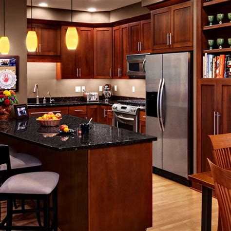 cherry wood kitchen cabinets with black granite cherry shaker cabinets dark granite kitchens