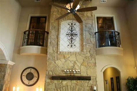 wall  tuscan great room great rooms stone fireplace