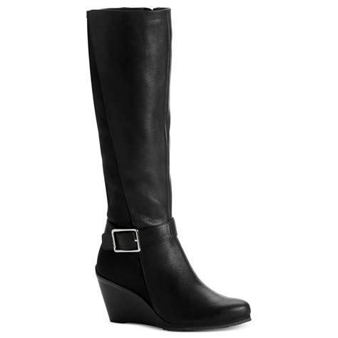 calvin klein taya wedge boots in black black black lyst