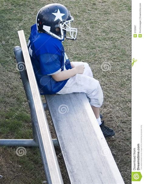 bench player youth football player alone on the bench royalty free