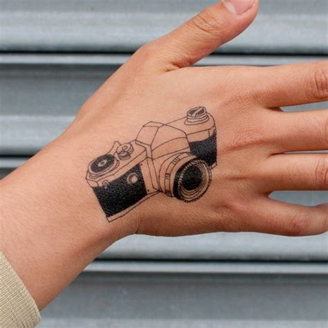 tattoo hand mini camera tattoo on hand tattoos pinterest camera