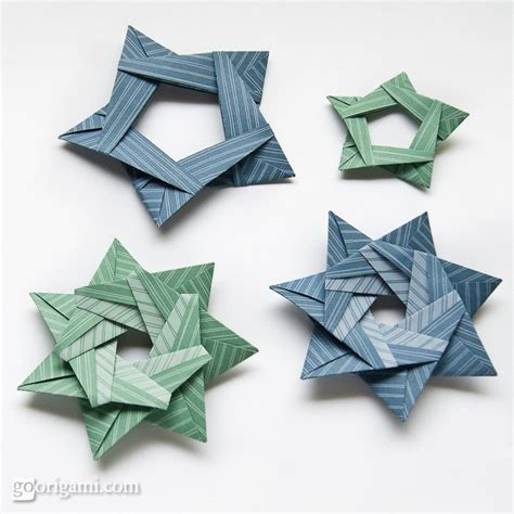 Origami 5 Pointed - origami from silver rectangles by sinayskaya