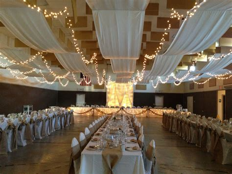 Church gym wedding decor draped ceiling rustic. We drilled