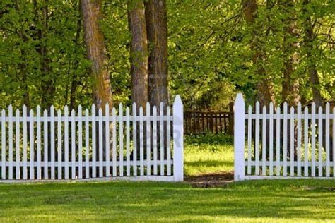 a white picket fence with an open gate to the park royalty free home interior design