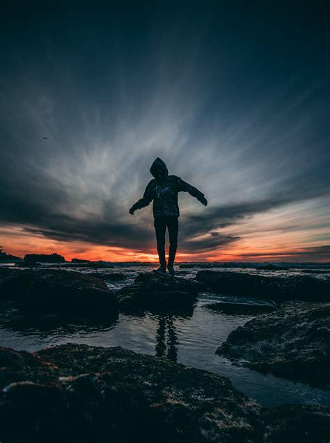 silhouette  man  nighttime  stock photo