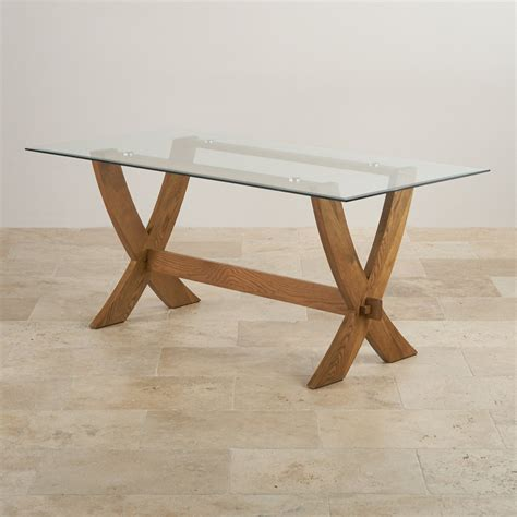 Glass Top Dining Table For 6 Reflection Glass Top Dining Table With Solid Oak Crossed Legs
