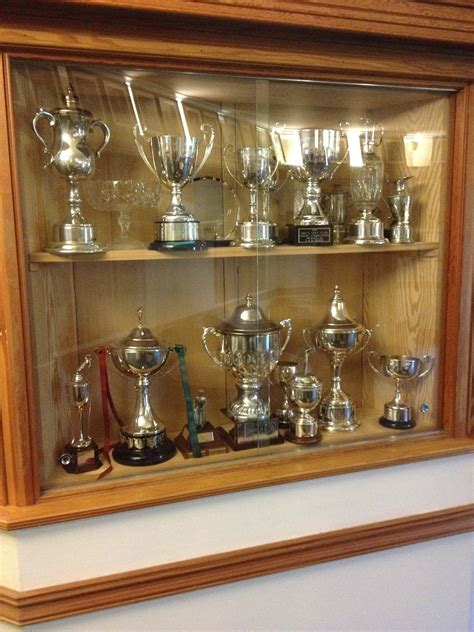 house of trophies club house trophy cabinet trophy case pinterest trophy cabinets house and kitchens