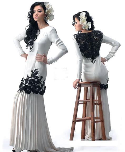 design baju gaun cantik seleksi kurung moden dengan perincian renda hitam serlah