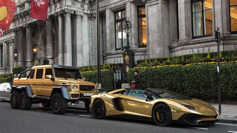 golden super cars arab billionaire with gold supercars and pet cheetah gq