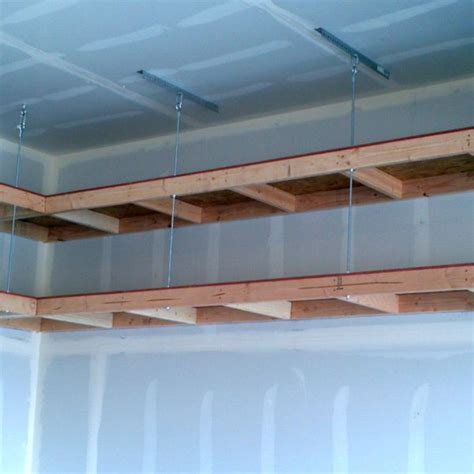 How To Build A Hanging Shelf In Garage by Best 25 Overhead Storage Ideas On