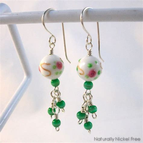bead earrings white glass bead earrings design with green bead