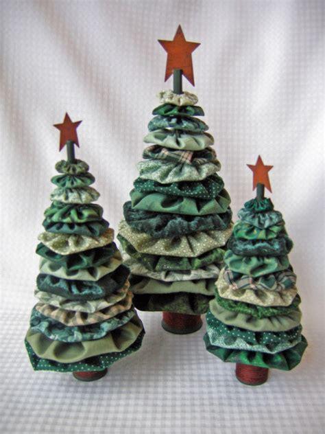 yo yo christmas trees by scrapthat on etsy