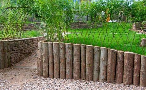 vertical logs  retaining wall garden pinterest