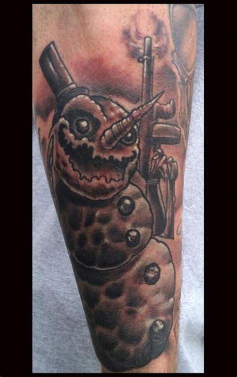 snowman tattoo evil snowman with a gun tattoomagz